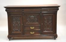 CARVED OAK SIDEBOARD WITH FACE OF NORTH WIND