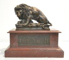 BRONZE SCULPTURE OF LION WITH WILD BOAR RAISED