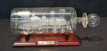 GLASS BLOWN TRAIN IN BOTTLE ON STAND
