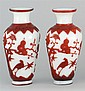 PAIR OF OVERLAY GLASS VASES In inverted pear shape with bird and prunus design in red on a milk-white ground. Four-character Qianlon...
