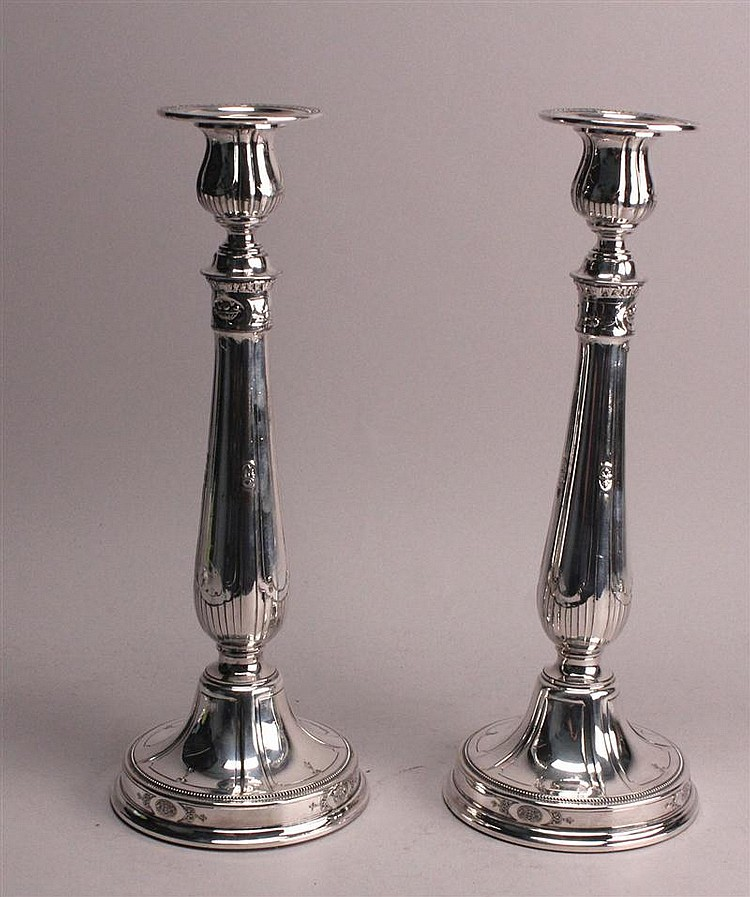 PAIR OF REED & BARTON SILVER PLATED CANDLESTICKS with raised floral decoration. Height 12