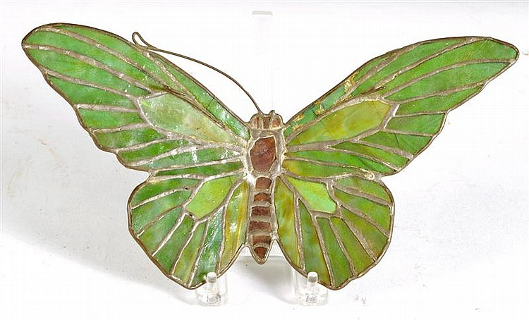 TIFFANY-STYLE LEADED GLASS ORNAMENT in the form of a butterfly with green wings and purple body. Length 11