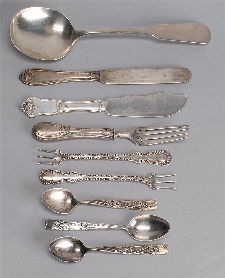 NINE SILVER ITEMS: two sterling silver oyster forks, three Tiffany sterling silver demitasse spoons, a sterling silver serving spoon...