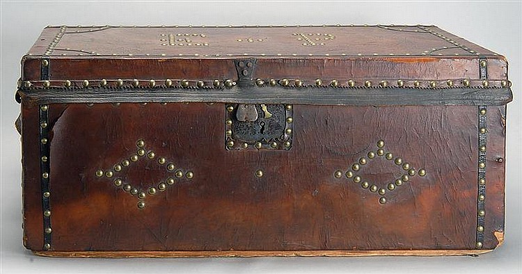 19TH CENTURY LEATHER-BOUND STORAGE TRUNK embellished with narrow leather strips and brass studded decoration. Marked