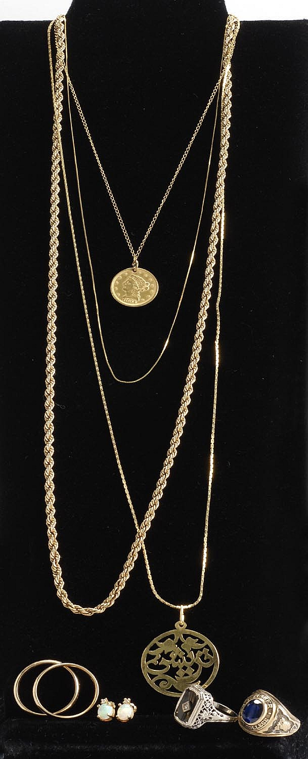 LOT OF ASSORTED GOLD JEWELRY. Including two wedding bands, pendant necklace with 2½ dollar gold piece, college ring, onyx ring, pair...