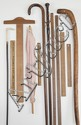 TEN ASSORTED RULERS AND CANES together with a parasol and a T-square. Includes two yardsticks, four rulers, and four canes including...