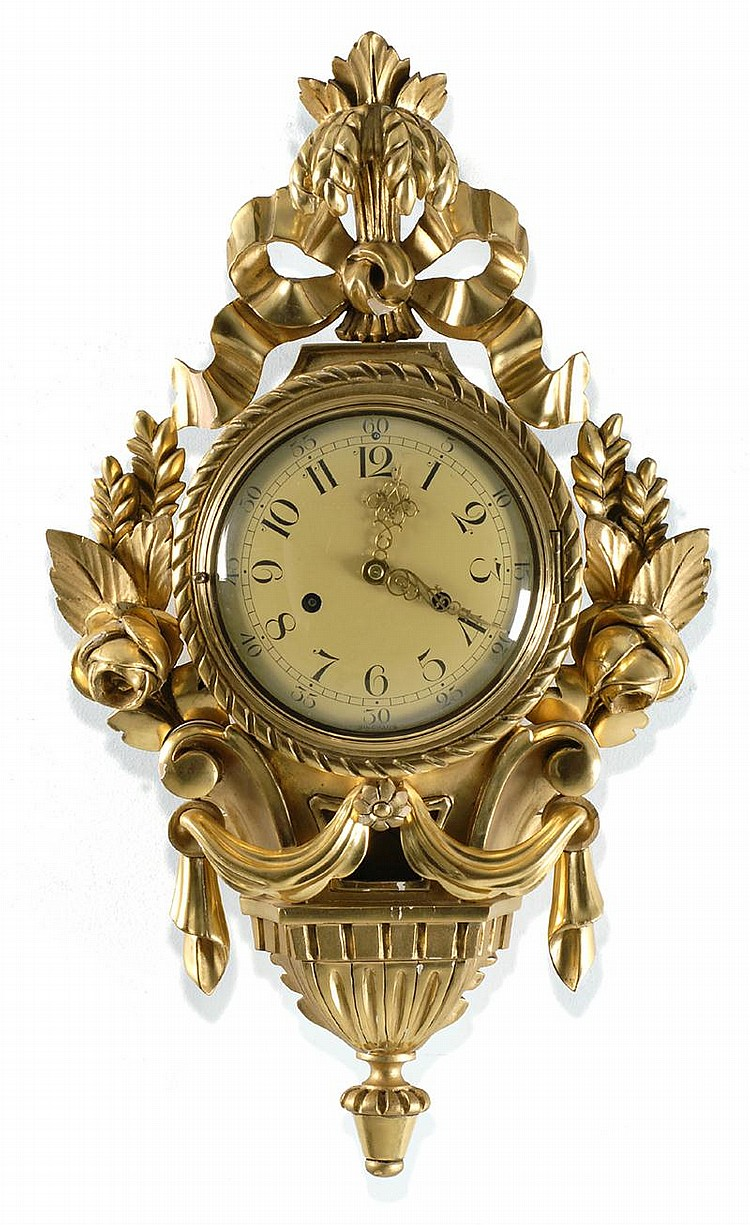SWEDISH WALL CLOCK (First Half of the 20th Century). Gilt body with fleur-de-lis crest and floral side mounts. Lower face signed