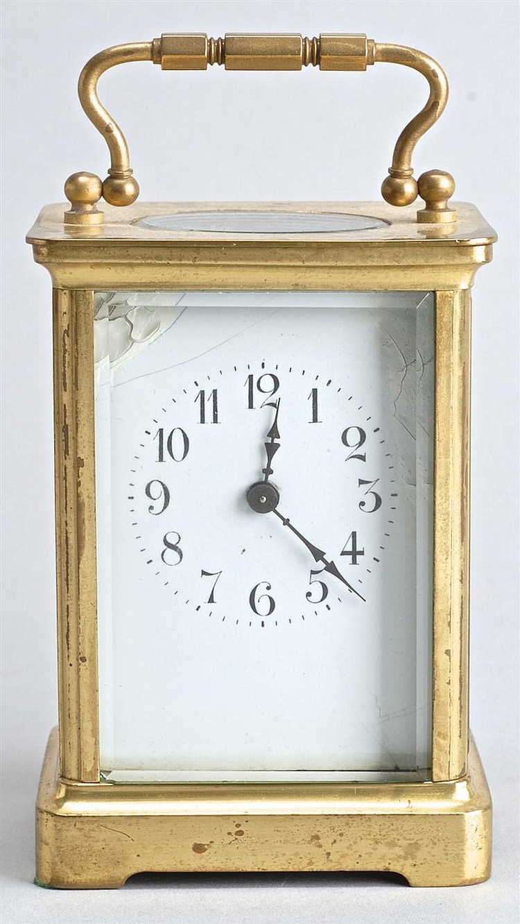LATE 19TH/EARLY 20TH CENTURY FRENCH CARRIAGE CLOCK in brass case with beveled glass. Height 4½
