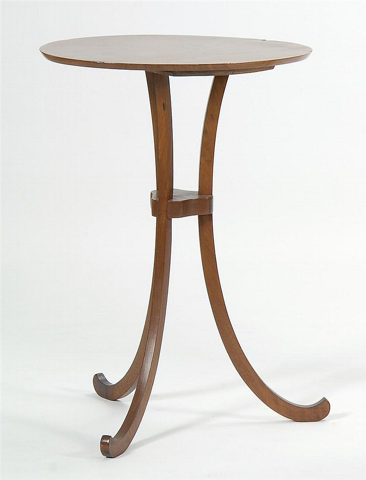 THREE-LEGGED CHERRY STAND with oval top and scrolled-out legs. Height 27½