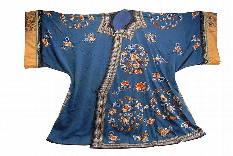 SILK NEEDLEWORK ROBE In a floral design on a blue ground.