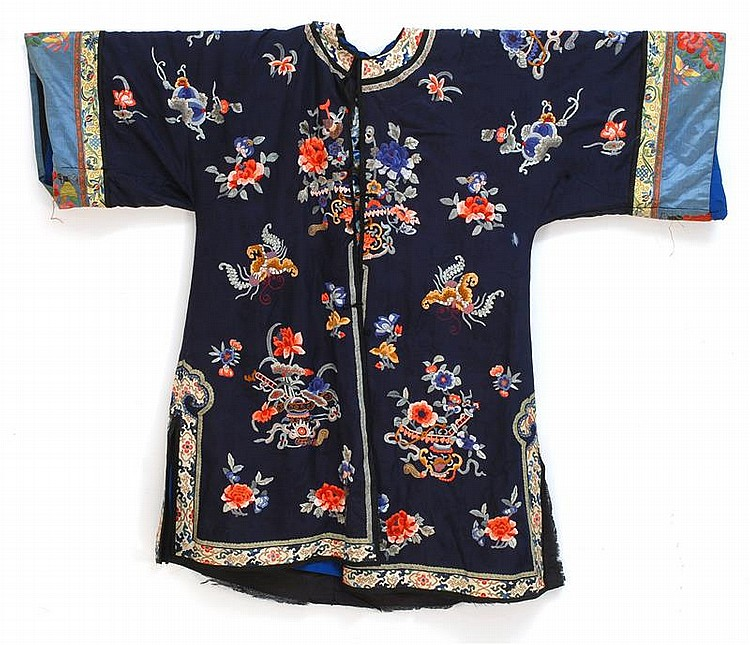 SILK NEEDLEWORK ROBE With butterfly and flower design on a dark blue brocade ground. Japanese silk lining.