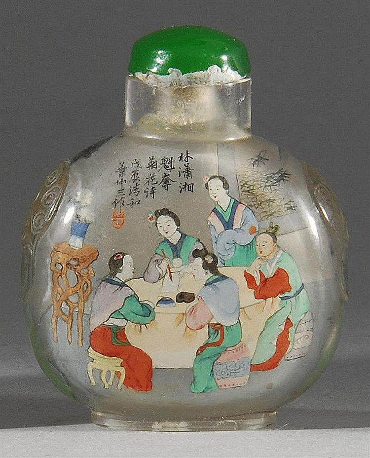 INTERIOR-PAINTED ROCK CRYSTAL SNUFF BOTTLE By Yeh Chung-san. In ovoid form with mask handles. Decorated with figures seated about a...