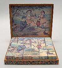 BOXED SET OF PUZZLE BLOCKS Decorated with various lithographed pictures. Lithographed label on box. 9