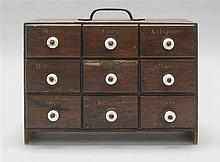 HANDLED NINE-DRAWER SPICE BOX In pine with ceramic handles. Height 7.7