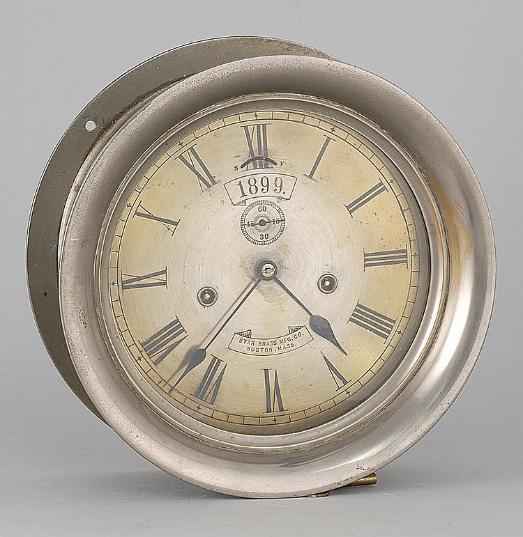 BRASS WALL-MOUNTED CLOCK By Star Brass Mfg. Co. Boston, Mass. Roman numeral dial marked boldy