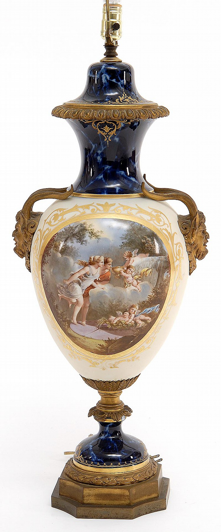 ORMOLU-MOUNTED PORCELAIN URN In the manner of Royal Vienna with decoration of cherubs and classical maidens. Satyr handles. Reverse...