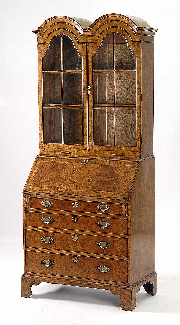 FINE REPRODUCTION OF AN 18TH CENTURY ENGLISH SECRETARY In walnut and burled walnut veneers. Upper case in double-arch form with glaz...