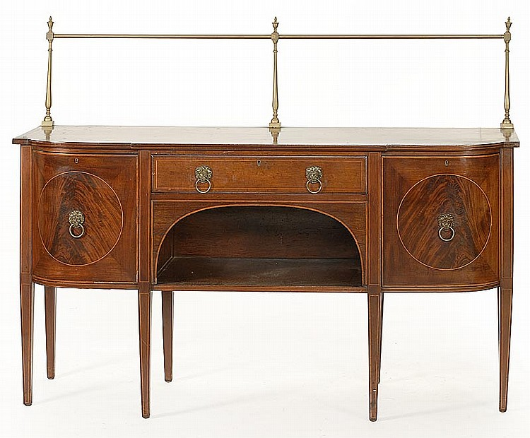 HEPPLEWHITE-STYLE SIDEBOARD In mahogany and mahogany veneers with banded and string inlay throughout top, doors and legs. Brass rod...