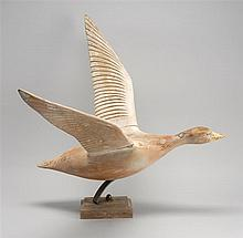 LIFE-SIZE WOODEN SNOW GOOSE OUTDOOR GARDEN ORNAMENT Shows traces of white paint. Carved wings. Mounted on a wooden base. Discovered...
