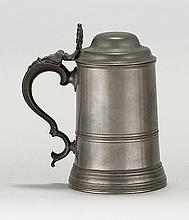 LONDON PEWTER QUART TANKARD By Watts and Harton, circa 1840-1850. Straight-sided body with engraved family crest and motto. Bottom o...