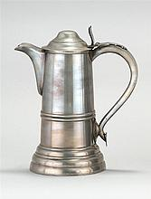 AMERICAN PEWTER CHURCH FLAGON By Reed & Barton of Taunton, Massachusetts. Handle terminates in a heart form. Height 11