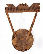 PRIMITIVE HARP Body made from an enameled metal bowl with hide covering. Pine frame. Length 19