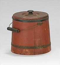 RARE COVERED WOODEN FIRKIN From Hingham, Massachusetts. Painted red with black bands. Cover with wooden knob. Swing handle. Circular...