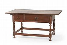 ANTIQUE AMERICAN PENNSYLVANIA TAVERN TABLE In walnut with brown finish. Overhanging top over two drawers of differing widths. Brass...