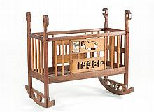 AMERICAN FOLK ART CRADLE In oak and maple. Posts with carved