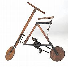 CHILD'S BICYCLE Wood and metal frame. Turned wooden wheels with rubber rims. Chain driven. Height 33.5