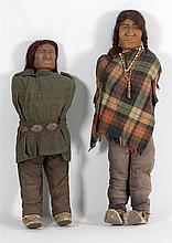 TWO CARVED AMERICAN NATIVE FIGURES Carved wooden heads mounted to stuffed wood-frame bodies. Dressed in western-style clothing. Heig...