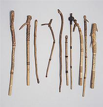 TEN CARVED TWIG POINTERS By William Abbott Willard (American, 1851-1939). Each with handles carved in varied forms including animal...