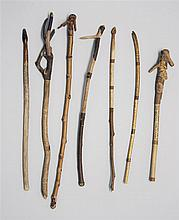 SEVEN CARVED TWIG POINTERS By William Abbott Willard (American, 1851-1939). Six with carved handles in varied forms. One with natura...