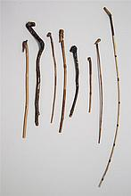 EIGHT CARVED TWIG POINTERS By William Abbott Willard (American, 1851-1939). Seven with carved handles. One with naturally formed han...