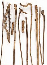 TWELVE CARVED TWIG ITEMS By William Abbott Willard (American, 1851-1939). Includes canes, pointers and cane handles. Lengths from 5
