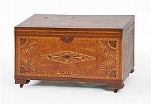 INLAID LIFT-TOP CHEST Extensive multiple wood geometric inlay to all sides and the entirety of the interior. Interior also with lift...