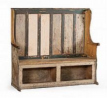 ANTIQUE SETTLE In pine with green highlights on an off-white ground with traces of red, black and other paint. Six-paneled back. Wav...