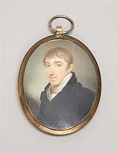 MINIATURE OVAL PORTRAIT Bust portrait of a gentleman with brown hair, blue eyes and wearing a black coat. Reverse of frame with a br...