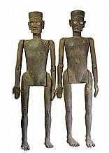 PAIR OF CARVED WOODEN JAVANESE FIGURES Jointed at neck, shoulders, elbows, hips and knees. Well-executed carving to faces, limbs, fi...
