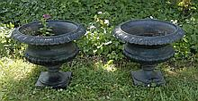 SMALL PAIR OF CAST IRON GARDEN URNS Painted black. Heights 17