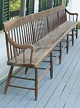 ANTIQUE AMERICAN MEETING HOUSE BENCH In pine and maple. Rodback-style with arms at each end. Turned legs with rod stretchers. Length...
