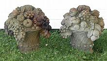 PAIR OF HADDONSTONE CAST CEMENT GARDEN SCULPTURES In the form of baskets overflowing with grapes and other fruit. Height 19