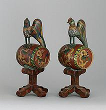 PAIR OF CLOISONNÉ ENAMEL ORNAMENTS In the form of roosters perched on dragon-decorated drums. Heights 10.2