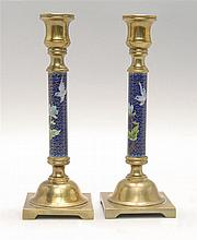 PAIR OF CLOISONNÉ ENAMEL CANDLESTICKS With bird and flower design on a blue ground. Height 9