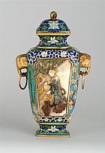 CLOISONNÉ ENAMEL AND HARDSTONE COVERED VASE In modified rectangular form with elephant's-head and loose ring handles. Body decorated...