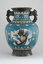 CHAMPLEVÉ ENAMEL VASE In baluster form with dragon's-head handles and dragon medallion decoration. Height 18.3