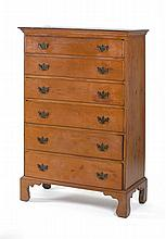 ANTIQUE AMERICAN CHIPPENDALE CHEST OF DRAWERS In cherry. Shaped cornice top over six graduated drawers with replaced brass pulls. Sh...