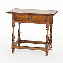 ONE-DRAWER TAVERN TABLE In hardwood and pine. Overhanging top with applied molded edge. Four block and turned legs connected by box...
