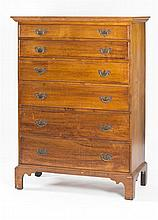 ANTIQUE AMERICAN SIX-DRAWER TALL CHEST In cherry. Graduated drawers with original hardware. High flat bracket base. Height 55.5
