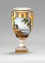 PARIS PORCELAIN URN Decorated with landscape and gilt highlighting. Swan-form handles. Height 9.75
